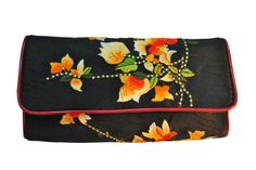 Small fabric clutch embroidered with pure satin threadsand highlighted with original Swarvoski elements