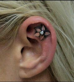 Flower ear tattoo.. This is actually kinda cute