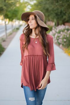 A gorgeous romantic peplum with bell sleeves in marsala. - Round neck - Ruffled hem - 3/4 length bell shaped sleeves - Made in the USA Model is 5'4 wearing a small. Runs true to size with a relaxed fi
