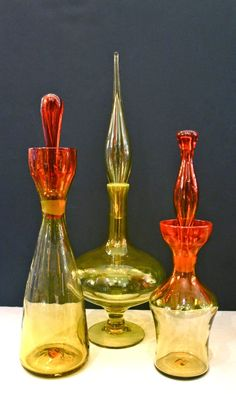 Decanters by Blenko (American), left: Amberina Decanter center: Lemon Decanter with flame stopper (a color only made in right: Amberina Decanter