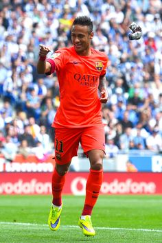 Neymar of FC Barcelona celebrates after scoring the opening goal during the La Liga match between RCD Espanyol and FC Barcelona at Cornella-El Prat Stadium on April 25, 2015 in Barcelona, Catalonia.