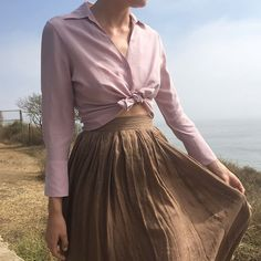 """Fall tones. Petal button down. 100% silk. Size 2-6 and $38 + shipping. Paired with nutmeg linen skirt. Fine pleating at waist. Size 25"""" or 0. $52 + shipping. First to comment with postal code for purchase. SHIRT SOLD"""