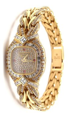 Patek Philippe Lady's Yellow Gold, Diamond and Ruby La Flamme Bracelet Watch, Ref. 4808 This watch is unworn and comes with all the papers and a Patek Philippe box. With 40 square-cut diamonds, total weight Two square-cut diamonds Ruby Bracelet, Diamond Bracelets, Bracelet Watch, Ankle Bracelets, Gold Watches Women, Luxury Watches For Men, Patek Philippe, Expensive Watches, Luxury Watches