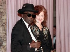 Blues guitarist and vocalist John Lee Hooker is escorted by singer Bonnie Raitt to the Rock and Roll Hall of Fame induction dinner , Jan. Hooker is among the inductees at the sixth annual dinner. Blue Company, Bonnie Raitt, John Lee Hooker, Slide Guitar, Music Is Life, Rock And Roll, Black Men, Dj, Blues