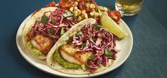 Fish tacos on menus at sit-down chains usually come clobbered with fried batter ,to make up for the tasteless, inexpensive fish they use. This recipe features tender mahi-mahi and avoids the calorie overload by featuring fresh, traditional toppings like red cabbage and avocado. To add to the flavor and beauty of the dish, you'll make a lively salsa out of bright cherry tomatoes and fresh roasted corn.