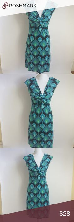 London Times Blue Green Dress In nice condition and made out of 95 % Polyester and 5  % Spandex.   Measurements   Chest-16 Inches from underarm to underarm.  Length- 31 Inches from top to bottom.    Bin 25 # 7 London Times Dresses