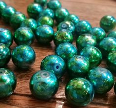 $2.50 Check out this item in my Etsy shop https://www.etsy.com/listing/216249527/12mm-green-teal-glass-beads