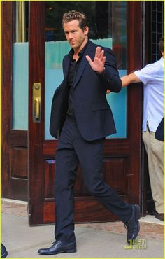 Ryan Reynolds suits up in navy with black underpinning.