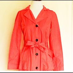 """NWT!  Perf for Spring Xhileration BeltedTrench NWT! Perfect for Spring!! Beautiful Xhileration Belted Trench Jacket - color is salmon/Peach - beautiful Ruffles on bottom gives you a great hourglass shape - BRAND NEW!! Bust 17"""", length 34.5"""", shoulders 14.5"""", sleeve underarm 18"""". Shell 55% cotton 45% polyester; lining 100% polyester. Includes extra button that is sewn into the tag underneath. Xhilaration Jackets & Coats Trench Coats"""