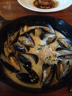 Brasserie Beck in Washington, D.C. The mussels arrive in a cast-iron skillet large enough that you'll scramble to make room for it on the table. Then, the big reveal: The server lifts the lid, filling your nostrils with an aromatic cloud of seafood steam. The plump mollusks inside come exclusively from Penn Cove in Puget Sound. The farm harvests them to order, helping to ensure they arrive at the restaurant fresh. The mussels mingle with chunks of fennel and Spanish-style cured spiced sausag...