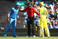 Rohit Sharma of India and Steve Smith of Australia exchange words as umpire Richard Kettleborough steps in during the 2015 Cricket World Cup Semi Final match between Australia and India at Sydney Cricket Ground on March 26, 2015 in Sydney, Australia.