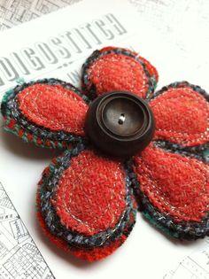 Orange tweed flower brooch with vintage button  by indigostitch