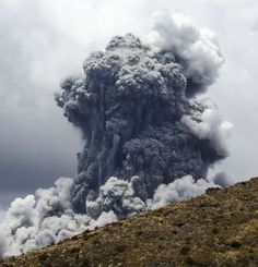 A massive plume of ash billows into the sky as Mount Tongariro erupts on November 21.