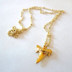 24K Gold Dipped Shark Tooth Necklace. $42.00, via Etsy.