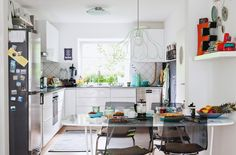 Add colourful accents to inject personality into a white kitchen