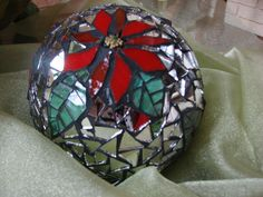 I made this large Christmas ball using cut mirror, stained glass, glass beads, black grout, adhered with Weldbond glue.