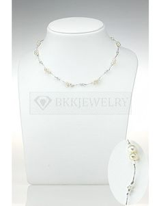 The epitome of elegance is this single strand necklace. A single thread of high-quality Japanese silk thread is used to carry shining white freshwater pearls, sparkling Japanese crystals and tiny, delicate beads. Feel like a lady every time you wear it.   Category Page: https://bkkjewelry.com/en/10045-freshwater-pearls-necklace