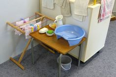 washing linens set up - idea for practical life activity at home