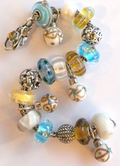 aqua blue and gold troll beads.