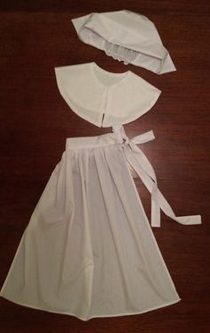 Items similar to Pilgrim girl 3 piece costume accessories on Etsy Pilgrim girl hat, collar, and apron made from white cotton muslin or linen. Please give measurements for waist and length (waist to he Pilgrim Outfit, Pilgrim Dresses, Pilgrim Costume, Homemade Costumes, Diy Costumes, Halloween Costumes, Clothing Patterns, Dress Patterns, Amish Dolls