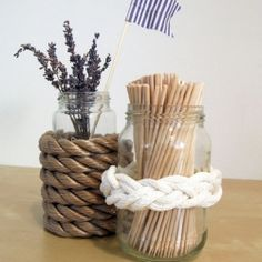 Ropes and knots are pretty hot right now so why not pretty up some plain glass jars with a little nautical feeling.
