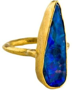 yellow gold Margery Hirschey cocktail ring featuring a free-form opal cabochon at center. Lightning Ridge, Cocktail Rings, Opal, Cocktails, Gemstone Rings, Gemstones, Gold, Jewelry, Craft Cocktails