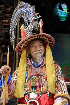 """Nakhi Dongba (Shaman or Wise Man) The Nakhi aka Naxi is a tribe living in the Tibetan Foothills of Yunnan and Sichuan Provinces in SW China and traditionally adherents to the Dongba Religion. The Dongba religion is based on the balanced relationship between nature and man. In Dongba mythology, """"Nature"""" and """"Man"""" are half-brothers, having different mothers. The religion is an off-shoot of the beliefs of the 900 year old Tibetan Bön religion. The word """"Dongba"""" literally means """"wise man"""" in the…"""