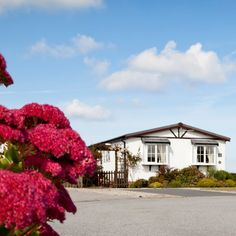 Situated on the wild and rugged North coast of Cornwall our holiday homes and park homes for sale are famous for their enviable location, just a stone's thro. Park Homes, Cornwall, Saints, Mansions, Watch, Nice, House Styles, Home Decor, Clock