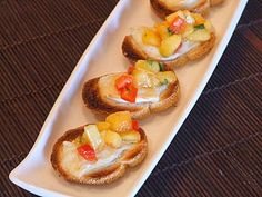 Bruschetta with Peach Salsa and Melted Brie. This dish is amazeballs!!!