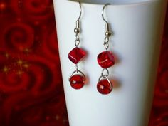 Modern looking but good with vintage too! These red glass earrings have a round and a square bead. They are 1 3/4 inch overall (including the ear