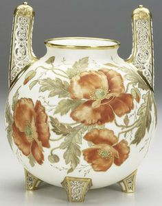 New Jersey, An American Belleek, Ott & Brewer porcelain spherical urn with four feet and two upright handles reticulated with gilded filigree, flanking largee orange poppies on a white ground. Circa 1882-1893