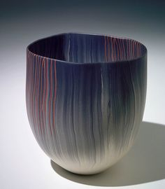 "Thomas Hoadley used the Japanese technique of nerikomi to create the delicate lines of color in this vessel. He stacked thousands of thin layers of colored clay to create a ""loaf,"" then cut the loaf into thin slices and assembled the pieces to create the bowl's final form. Stunning result!"