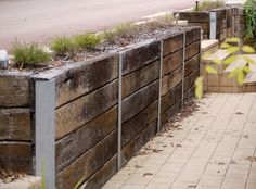 Retaining wall of recycled sleepers. Designed by Garden Insight Garden Retaining Wall, Garden On A Hill, Insight, Recycling, Yard, Projects, Design, Log Projects, Patio