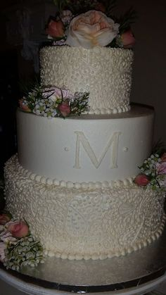 Beautiful paisley design , all buttercream icing accented with fresh flowers.