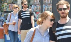 Emma Stone rests her head on Andrew Garfield's shoulder on city stroll