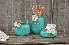 Rustic mason jar desk set. Hand painted in aqua, tied with jute and cream colored roses, finished with a protective coating. Accessorize your desk with a place to keep pencils, pens, scissors, busines