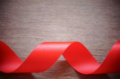 red ribbon on wooden can be used for display products