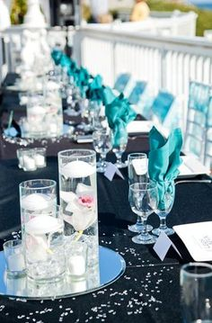BLACK AND TURQUOISE WEDDING...we could do white tables with pink flowers and teal napkins.