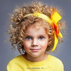 As much as I hated my curly hair as a kid, I hope if I have a girl she has curly hair. So cute! :)