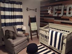 A rustic woodland nursery theme mixing classic, contemporary and rustic style for our little man.
