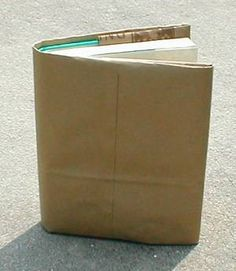 Covering textbooks with brown paper bags.  No spending money on fancy smancy pre-mades.