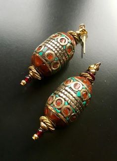 ROX Turquoise, Coral and Brass Inlay Tibetan Bead Earrings with Bali Brass, Gold Spacers and Vintage Glass.  $120 http://mkt.com/rox-minneapolis-jewelry #rox #roxmpls #roxmplsjewelry #roxjewelrympls #style #fashion #instafashion #turquoise #coral #brass #bali #tibet #glass #gold #earrings #tibetanbeads #art #design #accessories #shop #smallbusinesssaturday #buy