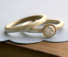 I so love a wedding ring like this! Why does a diamond represent love? wedding rings--so unique and pretty