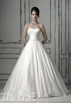 Gown features back waistline accented with askew detachable bow.