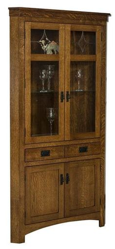 Amish Cape Cod Corner Hutch You've found just the right corner storage. This hutch comes with lots of options including wood type, finish, hardware, option to remove drawers, option to add silverware insert, fixed or adjustable lower shelf and more. Amish made in America.