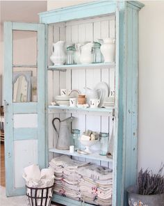 In love with this washed out robin's egg blue hutch
