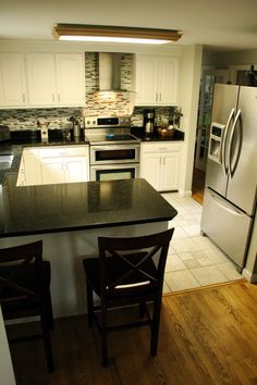 Like the dark countertops-white cabinets-interesting backsplash combo