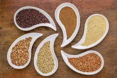 gluten free grain abstract - gluten free grain abstract - top view of teardrop shaped bowls with quinoa, teff, millet, rice, sorghum and buckwheat grains against grunge wood
