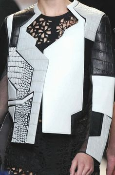 Graphic panelled jacket; creative pattern cutting; geometric fashion detail // Fendi Spring 2014