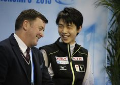 Yuzuru Hanyu of Japan sits with his coach after his performance in the Mens Short Program event in the ISU World Figure Skating Championship 2015 held at the Oriental Sports Center in Shanghai, China, Friday, March 27, 2015. Hanyu finished in first place in the event. (AP Photo/Ng Han Guan)